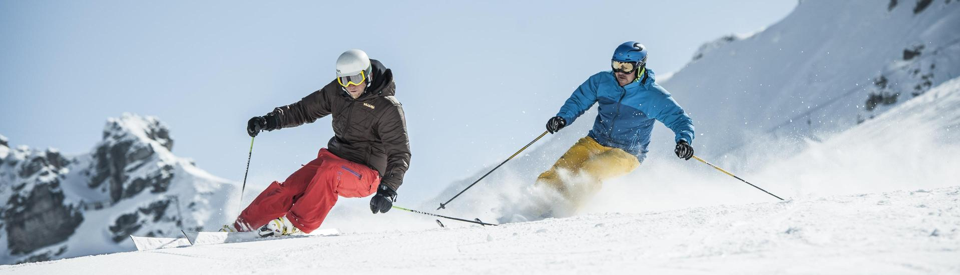 A skier practices the correct skiing technique during one of the private ski lessons in Sierra Nevada.