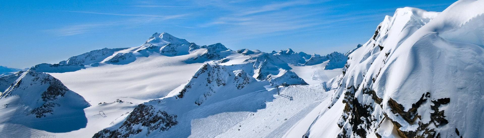 A view of a snowy mountain top in the ski resort of Valfréjus, where ski schools gather to start their ski lessons.